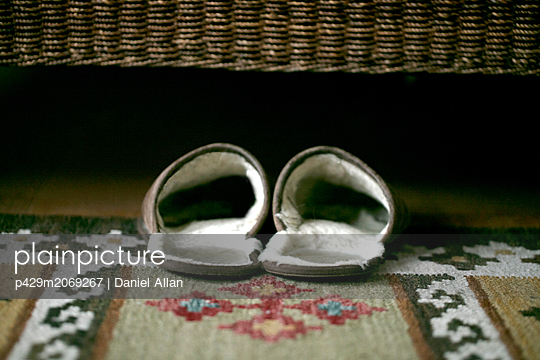 Slippers under bed - p429m2069267 by Daniel Allan