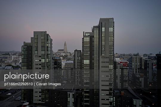Modern apartment buildings in evening - p1166m2292610 by Cavan Images