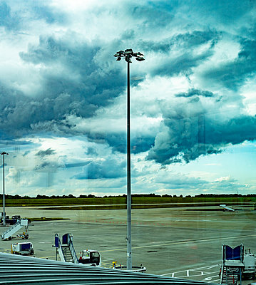 Thunderclouds over the airport in London - p1082m2099681 by Daniel Allan