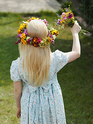 Rear view of a flower girl - p3018973f by Paul Hudson