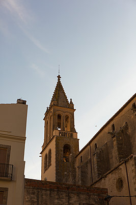 View of church with steeple in Palamos - p1177m1516854 by Philip Frowein