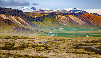 A beautiful long view across the colourful landscape of a valley from a tourist lookout; Iceland - p442m2012112 by Alanna Dumonceaux