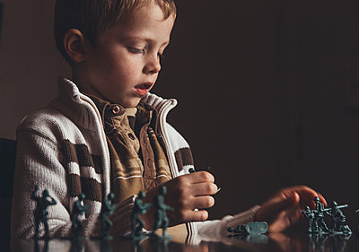 Child Playing With Army Men - p1262m1083678 by Maryanne Gobble