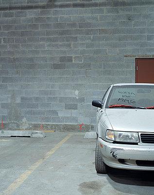 Unwashed car in parking garage - p3720356 by James Godman