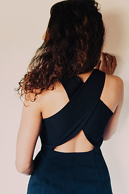 Back view of woman in a black dress - p1417m1487966 by Jessica Lia