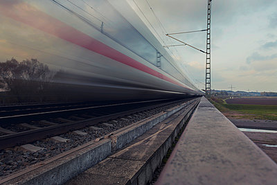 Germany; fast moving train in landscape - p300m919800 by Christian Richter