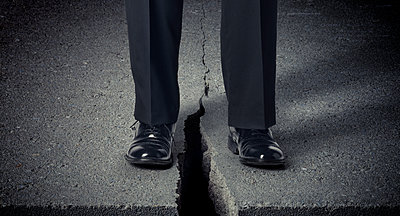 Cracked Sidewalk with Businessman - p394m1119906 by Stephen Webster