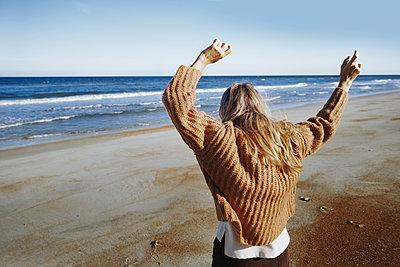 Happy woman dancing on the beach - p1577m2281000 by zhenikeyev