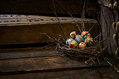 Easter eggs in twig nest - p312m2145883 by Magnus Ragnvid