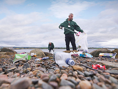 Environmentalist cleaning up beach - p42917315f by Monty Rakusen