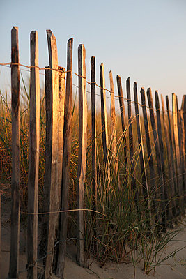 Fence on a beach - p7360010 by Nader Kabbany
