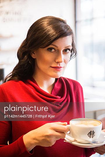 Woman drinking white coffee