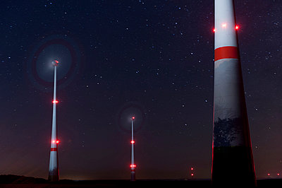 Wind turbines at night - p1079m891435 by Ulrich Mertens