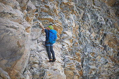 Climber ascends headwall of Douglas Peak, British Columbia. - p1166m2095164 by Cavan Images