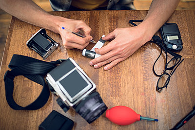 Photographer writing on film reel - p1315m1514371 by Wavebreak