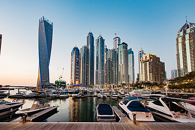 Modern buildings and harbor against clear sky - p1166m1142547 by Cavan Images