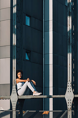 Female teenager on bridge - p728m2038820 by Peter Nitsch
