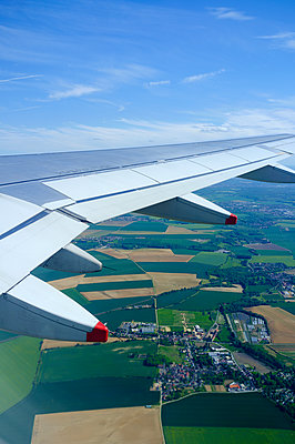 Window view of fields and a wing during flight take-off - p1096m1444354 by Rajkumar Singh