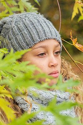 Portrait of a girl in a park, Autumn - p1323m1190228 by Sarah Toure