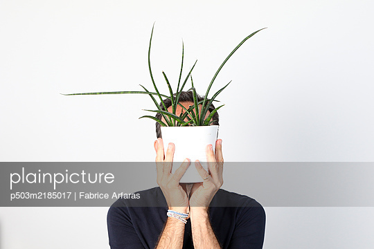 man with plant head - p503m2185017 by Fabrice Arfaras