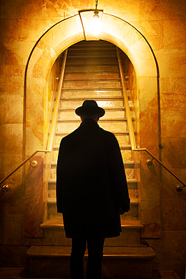 Silhouette of Man in Hat at Stairwell  - p1248m2063488 by miguel sobreira