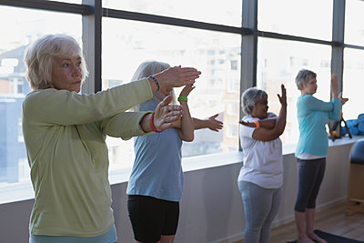 Group of senior women performing yoga - p1315m2017858 by Wavebreak