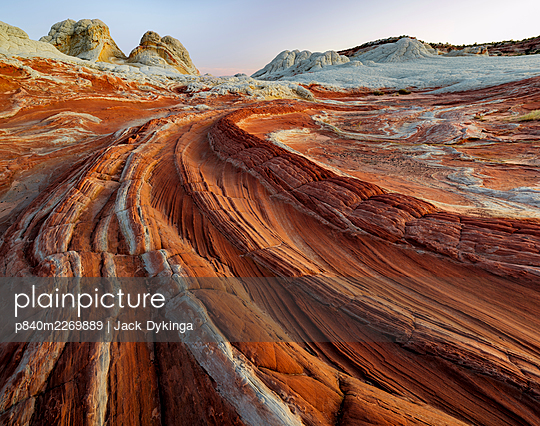 Petrified sand dunes with deeply eroded sinuous striations. Colorado Plateau, Arizona, USA. September 2019. - p840m2269889 by Jack Dykinga