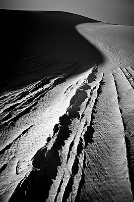 Lines of white sand and s-curve shadow.  White Sands National Park, Alamogordo, New Mexico. - p1424m1501663 by Dan Ballard