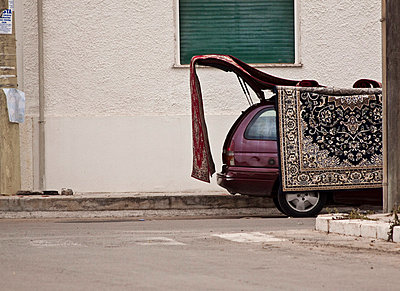 Carpets hanging on a car - p8580028 by Lucja Romanowska