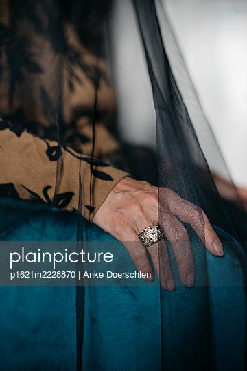 Hand under black veil - p1621m2228870 by Anke Doerschlen