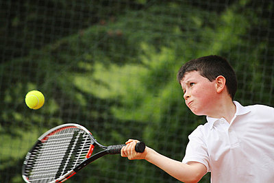 Boy Hitting Forehand Shot - p3071255f by Koji Aoki