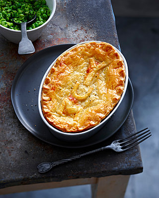 Dish of baked pie and peas - p429m1450663 by BRETT STEVENS