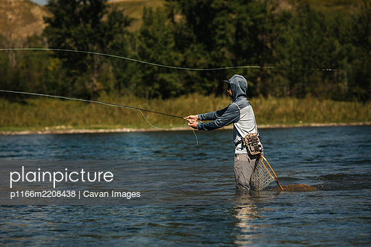 Fly Fishing in the river - p1166m2208438 by Cavan Images