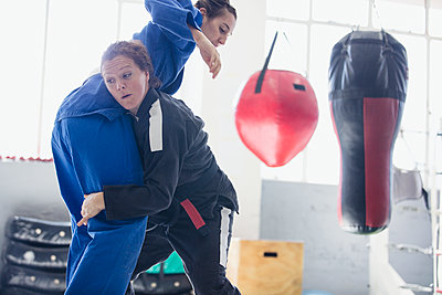 Determined women practicing judo in gym - p1023m1506465 by Sam Edwards