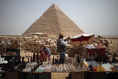 Selling Souvenir by the Gizeh Pyramids - p1610m2181481 by myriam tirler