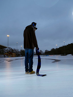 A sad and lonely young man on the ice Sweden - p31223890f by Alex  Martin Photographers