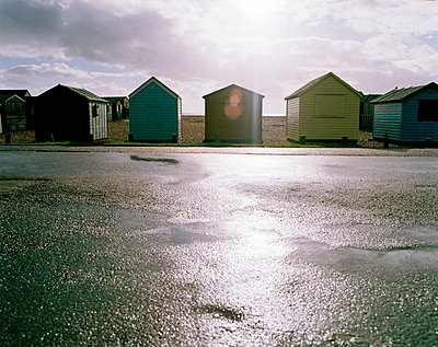 Row of beach huts - p388m877041 by Bill Davies