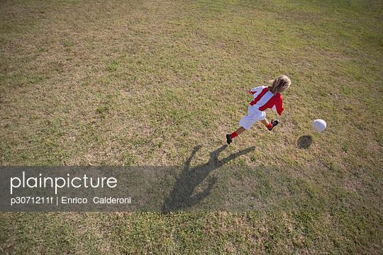 Footballer kicking soccer ball