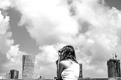 Woman against skyline of Tel Aviv - p1484m2150261 by Céline Nieszawer