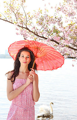 Girl with a parasol - p045m813653 by Jasmin Sander