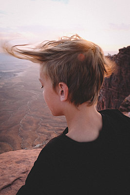 Wind Blowing Boy's Hair over Canyonlands Viewpoint. - p1166m2246431 by Cavan Images