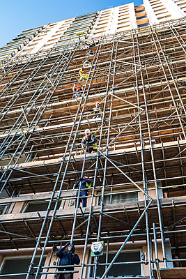 Construction workers on a scaffolding - p1291m2172078 by Marcus Bastel