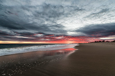 Ocean waves on beach at sunset - p555m1232009 by Patrick Lienin