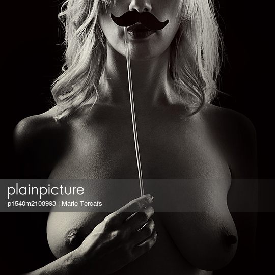 Topless blonde with fake moustache - p1540m2108993 by Marie Tercafs