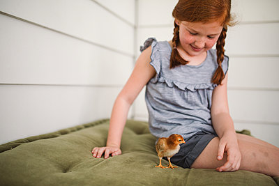Red-haired girl and chick - p1361m1461367 by Suzanne Gipson