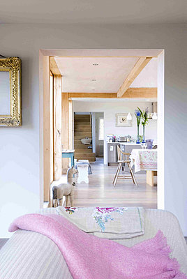 Open plan living area with views through to kitchen - p349m790643 by Polly Eltes