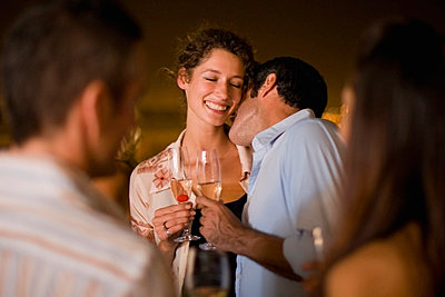 Couple kissing at party at night - p42913973f by Zero Creatives
