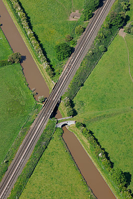 Aerial view of a canal & railway crossover - p1048m2088074 by Mark Wagner