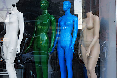 Different colored nude mannequins in a store window. - p343m1554729 by Ron Koeberer