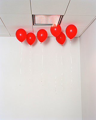 Red ballons in office - p3721918 by James Godman
